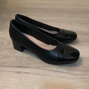 Black heels. Patent rounded squeaker toe